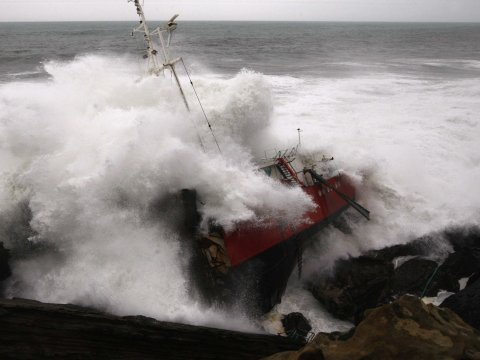 wrecked boat waves storm