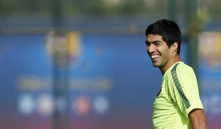 Barcelona's players Luis Suarez smiles during a training session at Joan Gamper training camp