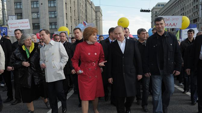 Russian President Dmitry  Medvedev, second left, and President-elect, Prime Minister Vladimir Putin, center, walk in a May Day demonstration in Moscow, Tuesday, May 1, 2012. Around 100,000 people in Moscow, including President Dmitry Medvedev and President-elect, Prime Minister Vladimir Putin, took part in the main march through the city center. (AP Photo/RIA-Novosti, Alexei Druzhinin, Government Press Service)
