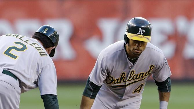 Oakland Athletics' Coco Crisp, right, is congratulated by third base coach Mike Gallego as he rounds the bases on his home run against the Seattle Mariners in the sixth inning of a baseball game Friday, June 21, 2013, in Seattle. (AP Photo/Elaine Thompson)