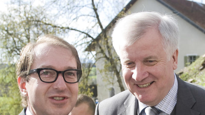 """FILE - In this April 21, 2012 file photo general secretary of the Bavarian Christian Social Union, CSU, Alexander Dobrindt and Bavarian Prime Minister Horst Seehofer share a word in Andechs, southern Germany. Dobrindt was quoted as telling the mass-circulation Bild am Sonntag newspaper that """"there is no way past a Greek exit from the eurozone"""" and added: """"I see Greece outside the eurozone in 2013."""" (AP Photo/dapd, Lennart Preiss)"""