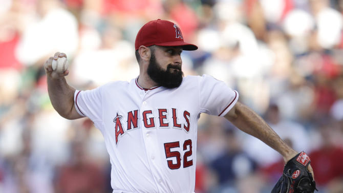 Navarro hits 1st homer, Angels beat Verlander 4-0