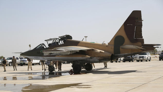 A Russian Sukhoi Su-25 fighter plane arrives at Iraq's al-Muthanna military airbase at Baghdad airport, in Baghdad