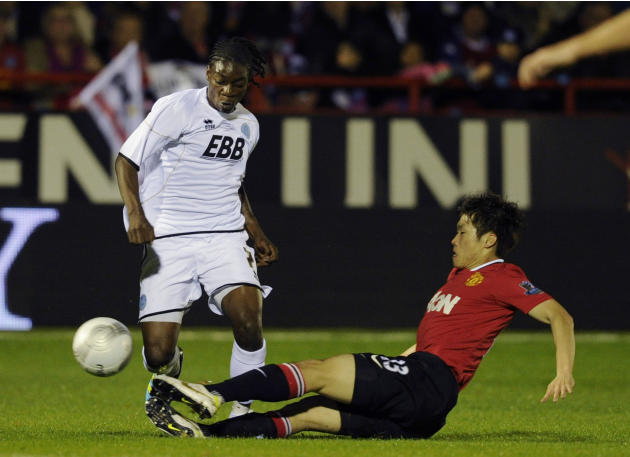 Aldershot Town's Jermaine McGlashan, left, is tackled by Manchester United's Ji-Sung Park during their English League Cup soccer match at the EBB stadium, Aldershot, south of London, Tuesday, Oct. 25,