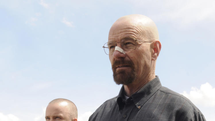 "This image released by AMC shows Bryan Cranston as Walter White, right, and Aaron Paul as Jesse Pinkman in a scene from the season 5 premiere of ""Breaking Bad,"" airing Sunday, July 15, at 10 p.m. EST on AMC. (AP Photo/AMC, Ursula Coyote)"