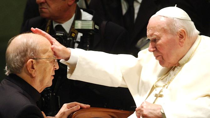"""FILE - In this Nov. 30, 2004 file photo, Pope John Paul II gives his blessing to late father Marcial Maciel, founder of Christ's Legionaries, during a special audience the pontiff granted to about four thousand participants of the Regnum Christi movement, at the Vatican.The troubled Legion of Christ religious order this week begins electing a new leadership for the first time since its founder, held up as a model by the Vatican, was revealed to have been a pedophile and fraud. The process will formally end the Vatican's three-year rehabilitation of the order, which the Legion is touting as a success and critics have dismissed as a sham. Several former Legion priests have written Pope Francis urging him to not fall for the Legion's """"supposed reform,"""" saying the process had ignored the core issues of the congregation's dysfunction: financial duplicity, lack of an authentic religious identity and continued coverup about those who facilitated the crimes of the founder. (AP Photo/Plinio Lepri, File)"""