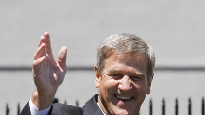 """FILE - This May 10, 2010 file photo shows Boston Bruins hockey great Bobby Orr waving to the crowd during an unveiling ceremony for a statue of Orr, in front of the TD Garden sports arena, in Boston. """"Orr: My Story"""" will be released in October by G.P. Putnam's Sons. The former Bruins defenseman and three-time Hart Trophy winner as the National Hockey League's most valuable player is promising to share some experiences he believes """"worth putting down on paper."""" According to Tuesday's, Jan. 8, 2013 announcement by Putnam, Orr will reflect on his remarkable career and on his angry break from his former agent and close friend Alan Eagleson.  (AP Photo/Steven Senne, File)"""