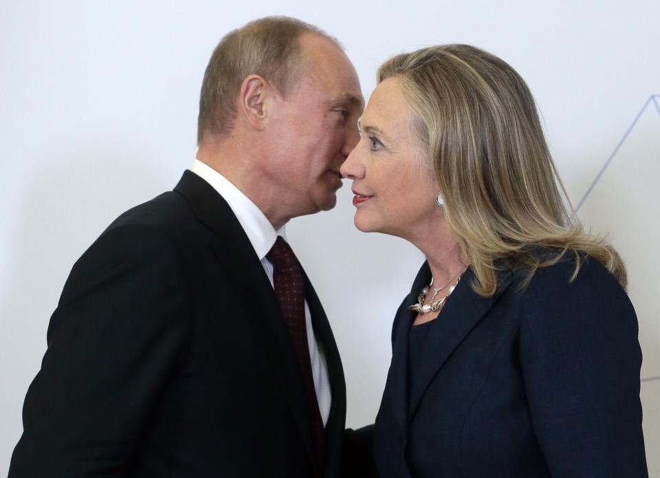Russian President Vladimir Putin, left, meets U.S. Secretary of State Hillary Rodham Clinton on her arrival at the APEC summit in Vladivostok, Russia, Saturday, Sept. 8, 2012. (AP Photo/Mikhail Metzel,Pool)
