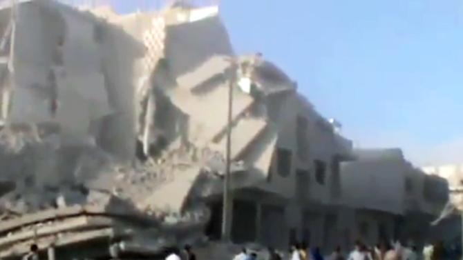 In this image taken from video obtained from Ugarit News, which has been authenticated based on its contents and other AP reporting, destruction of a residential area is seen in the aftermath of Syrian airstrikes on Maarat al-Numan, Idlib, Syria, Tuesday, Oct. 16, 2012. (AP Photo/Ugarit News via AP video)