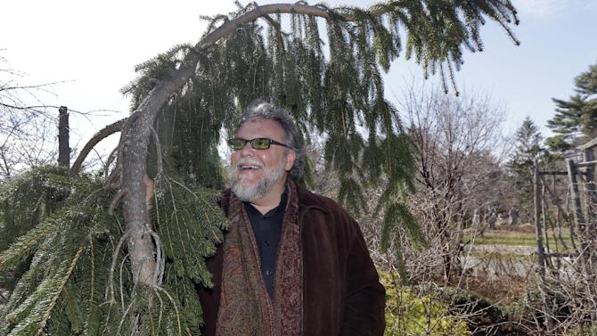 John Forti, horticultural director for the Massachusetts Horticultural Society, poses at Elm Bank in Wellesley, Mass., Thursday, April 16, 2015. The barrage of snow and cold in New England this winter has pushed back the gardening season and left behind damaged bushes, trees and greenhouses and gardeners eager to get outside and in the dirt. Forti says the weight of the snow broke tree limbs and crushed shrubs as it fell off roofs. But the good news is that the water table is up significantly, which will help plants recovering from the tough winter. (AP Photo/Elise Amendola)