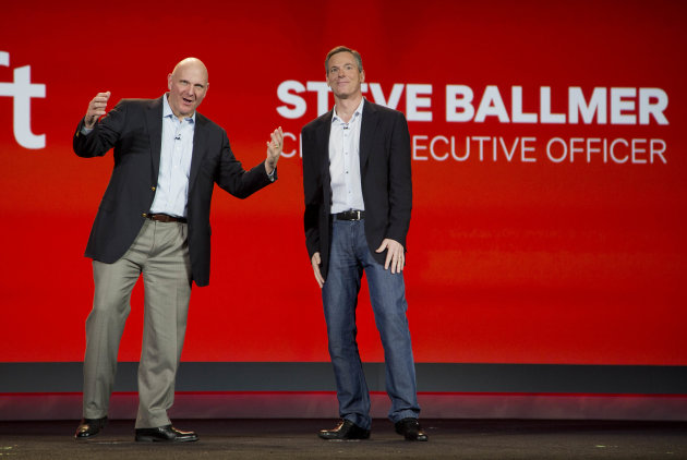 In this Monday, Jan. 7, 2013, file photo, Microsoft CEO Steve Ballmer, left, and Qualcomm CEO Paul Jacobs speak during Jacobs' keynote address at the Consumer Electronics Show, in Las Vegas. Microsoft's latest quarterly earnings for the last quarter of 2012 slipped, even as the world's largest software maker showed modest progress adjusting to a shift away from the personal computers that have been its financial foundation for decades. (AP Photo/Julie Jacobson, File)