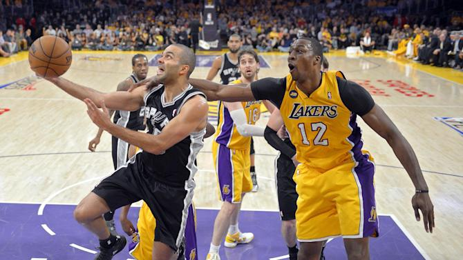 San Antonio Spurs guard Tony Parker, left, of France, goes up for a shot as Los Angeles Lakers center Dwight Howard defends during the second half in Game 3 of a first-round NBA basketball playoff series, Friday, April 26, 2013, in Los Angeles. The Spurs won 120-89. (AP Photo/Mark J. Terrill)