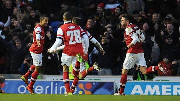 Arsenal's Theo Walcott (left) celebrates scoring his side's third goal with his team-mates