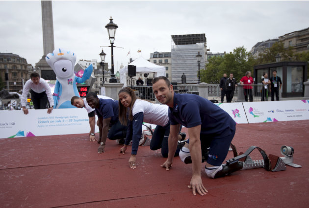 Sebastian Coe, left, the chairman of the London Organising Committee for the 2012 Olympic Games poses for photographs with the London Olympic Games paralympic mascot Mandeville, second from left, and