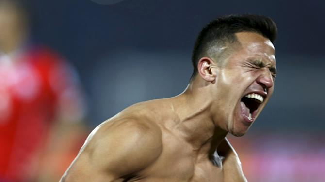 Chile's Alexis Sanchez celebrates after scoring the winning penalty kick in their Copa America 2015 final soccer match against Argentina at the National Stadium in Santiago