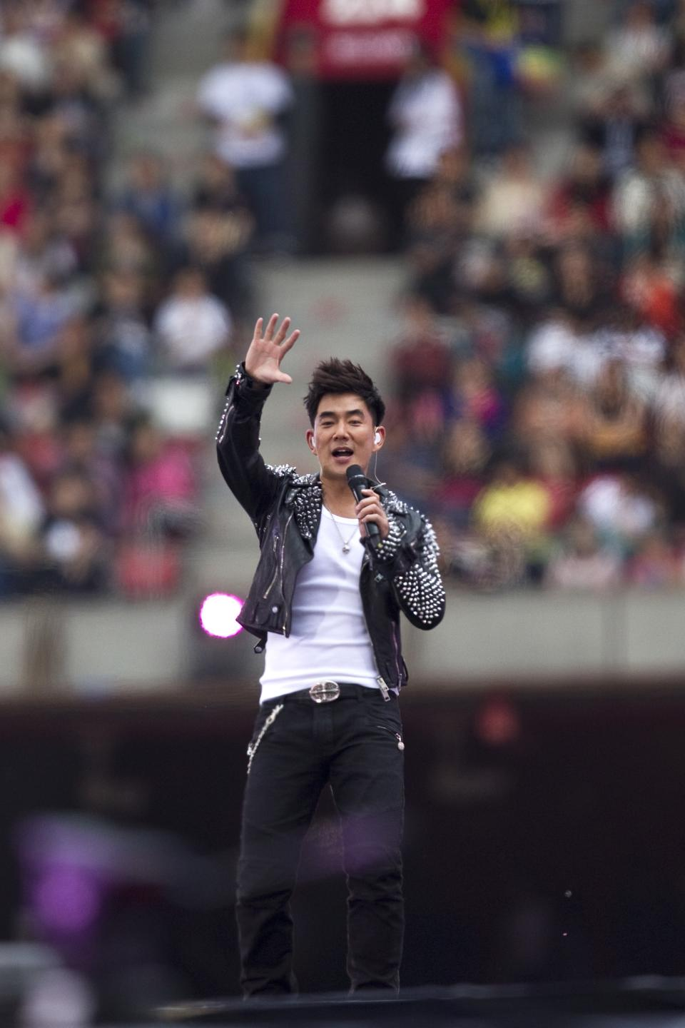 Taiwanese actor and singer Richie Jen performs during the Rock Records' 30th Anniversary Beijing Concert in China's National Stadium, also known as the bird's nest, in Beijing, China, Sunday, May 1, 2011. (AP Photo/Alexander F. Yuan)