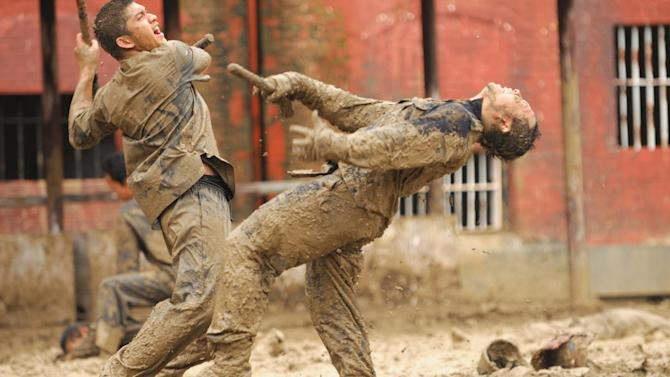 """This image released by Sony Pictures Classics shows Iko Uwais as Rama, left, in a scene from The Raid 2."""" (AP Photo/Sony Pictures Classics)"""