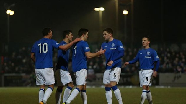 Rangers celebrate Andrew Little's, centre, opener