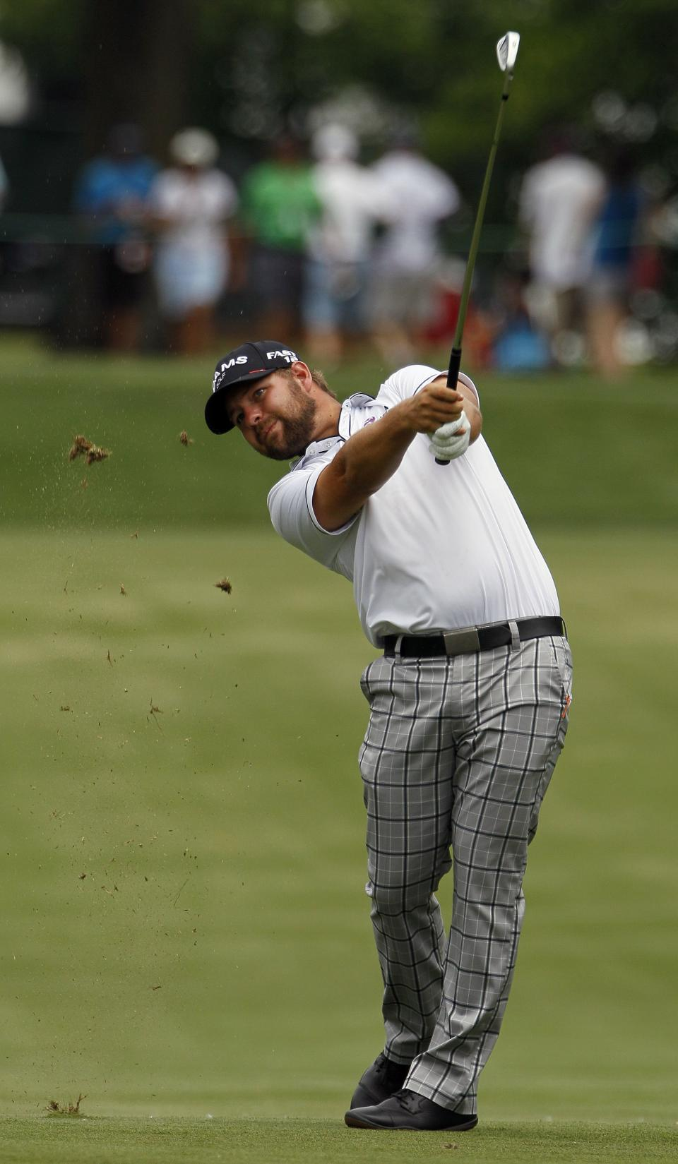 Ryan Moore hits from the first fairway  during the third round of the Wells Fargo Championship golf tournament at Quail Hollow Club in Charlotte, N.C., Saturday, May 5, 2012. (AP Photo/Gerry Broome)