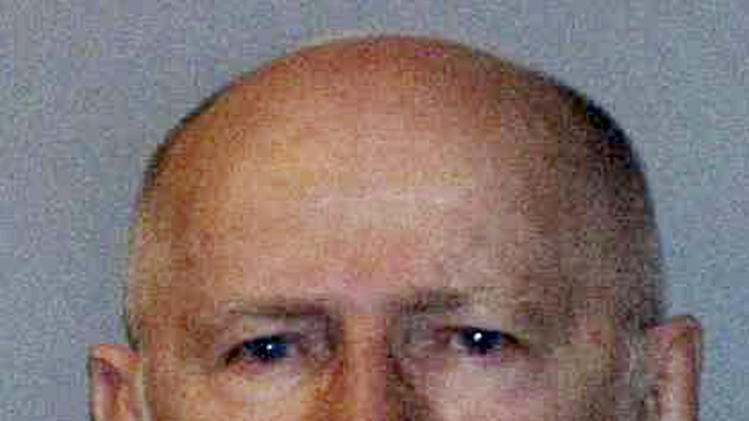 """FILE - This June 23, 2011 file booking photo provided by the U.S. Marshals Service shows James """"Whitey"""" Bulger.  A federal judge in Boston will hear arguments Wednesday, Feb. 13, 2013, on Bulger's claim that he was given immunity to commit crimes while he was an FBI informant. Bulger's lawyers want to use his immunity claim as a defense at his upcoming trial. (AP Photo/U.S. Marshals Service, File)"""