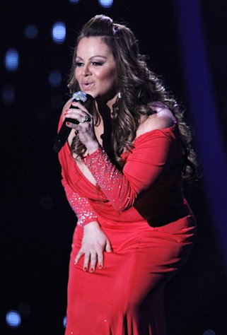 FILE - In this April 26, 2012, file photo, singing superstar Jenni Rivera performs during the Latin Billboard Awards in Coral Gables, Fla. Authorities in Mexico say the wreckage of a small plane believed to be carrying Rivera has been found on Sunday, Dec. 9, 2012, and there are no apparent survivors. (AP Photo/Lynne Sladky, file)