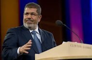 Egypt&#39;s President Mohamed Morsi, pictured in September 2012, on Monday decided to pardon all those arrested between the start of the revolution that toppled president Hosni Mubarak in February 2011 and June this year, state media said