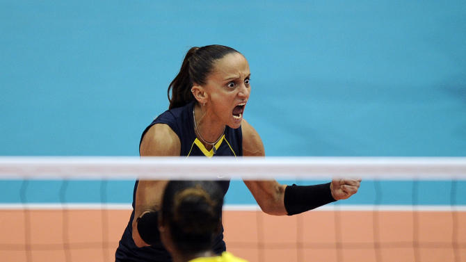 Fabiana De Oliveira from Brazil reacts during a women's volleyball final match against Cuba at the Pan American Games in Guadalajara, Mexico, Thursday, Oct. 20, 2011. (AP Photo/Daniel Ochoa de Olza)