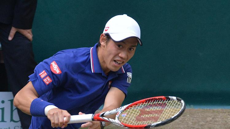 Kei Nishikori from Japan eyes the ball during his match against Swiss Roger Federer at the ATP Gerry Weber Open tennis tournament in Halle, western Germany on June 14, 2014