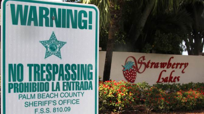 """FILE - In this Friday, March 16, 2012 file photo, a """"No Trespassing"""" sign is shown in front a neighborhood of 262 homes called Strawberry Lakes, in Lake Worth, Fla. National foreclosure trends took a positive turn in April, as the number of homes seized by banks declined and fewer properties entered into the foreclosure process RealtyTrac Inc. said Thursday May 17, 2012. But state-level data point to potentially more home repossessions ahead in Florida and many of the 25 other states where courts are required to sign off on foreclosures. (AP Photo/Wilfredo Lee)"""