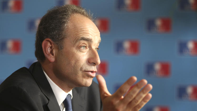 """iHead of France's UMP ruling party, Jean-Francois Cope reacts at the party headquarters during an interview with the Associated Press in Paris, Wednesday, April 27, 2011.  Cope says France cannot afford to take in waves of North African migrants looking for jobs but that shutting down European borders would be a """"joke."""" France and Italy have been at odds over how to deal with more than 20,000 illegal Tunisian migrants who entered the European Union via the small Italian island of Lampedusa in recent weeks. (AP Photo/Michel Euler)"""
