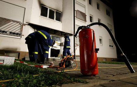 A fire extinguisher is seen outside a building used to house asylum seekers after a fire broke out in the entrance area of the building in Heppenheim
