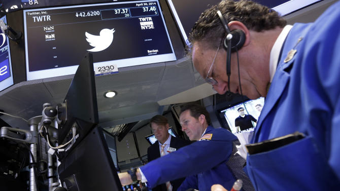 FILE - In this April 30, 2014 file photo, trader Steven Kaplan, right, works at the post that handles Twitter, on the floor of the New York Stock Exchange. Twitter, which peaked at $74.73 late last year, is down more than half from its peak, including a plunge Tuesday, May 6, 2014 after company insiders were allowed to sell stock for the first time since its IPO. (AP Photo/File)