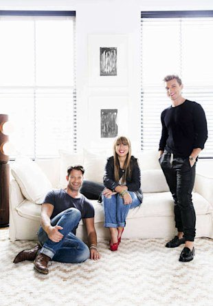Rita Hazan relaxes with her friends Nate Berkus and Jeremiah Brent in the bright and airy living room of her Manhattan loft.