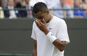 Nick Kyrgios of Australia reacts during his men's singles quarter-final tennis match against Milos Raonic of Canada at the Wimbledon Tennis Championships, in London