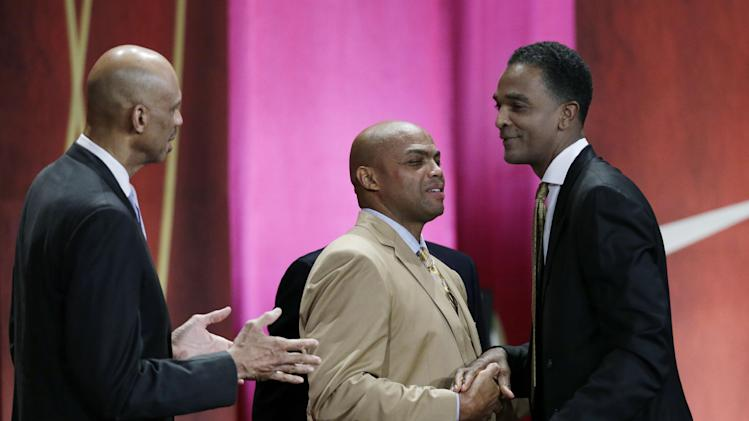 Inductee Ralph Sampson, right, is congratulated by Kareem Abdul Jabbar, far left, and Charles Barkley, middle, during the enshrinement ceremony for the 2012 class of the Naismith Memorial Basketball Hall of Fame at Symphony Hall in Springfield, Mass. Friday, Sept. 7, 2012. (AP Photo/Elise Amendola)