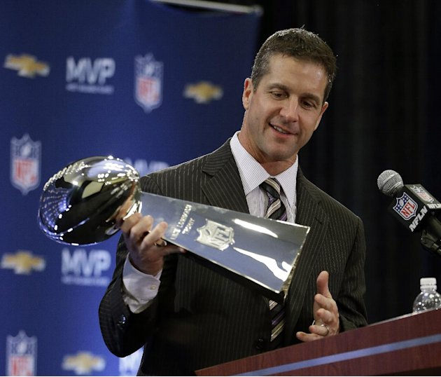 Baltimore Ravens head coach John Harbaugh holds the Vince Lombardi Trophy during a news conference after NFL Super Bowl XLVII football game Monday, Feb. 4, 2013, in New Orleans. The Ravens defeated th
