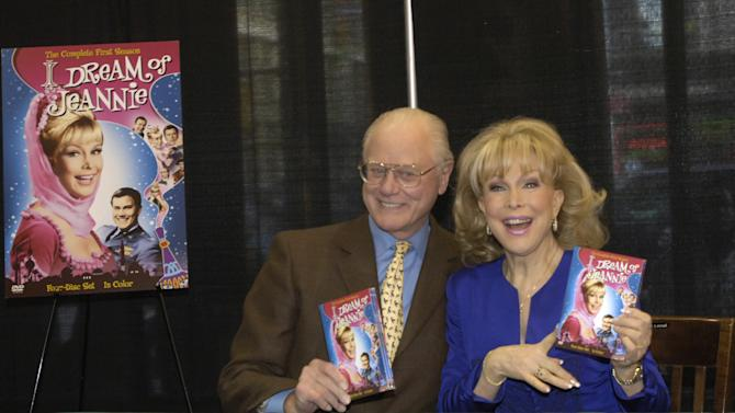 """FILE - In this Wednesday, March 15, 2006 file photo, """"I Dream of Jeannie"""" co-stars Barbara Eden and Larry Hagman pose for photos before signing copies of the newly-released first season DVD of their television show at a bookstore in New York.  Actor Larry Hagman, who for more than a decade played villainous patriarch JR Ewing in the TV soap Dallas, has died at the age of 81, his family said Saturday Nov. 24, 2012. (AP Photo/Jason DeCrow)"""