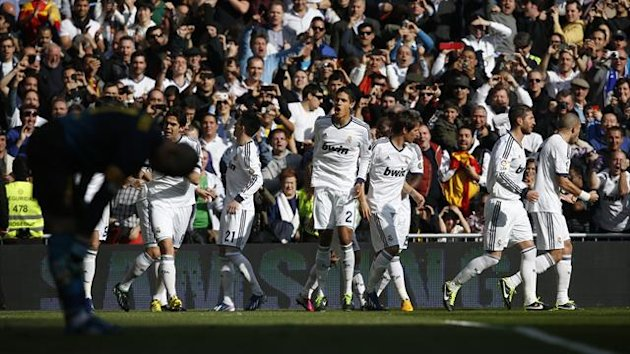 Real Madrid players celebrate Karim Benzema's goal against Barcelona (Reuters)