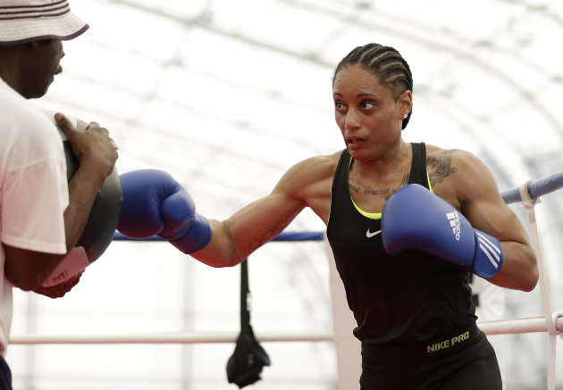 In this Thursday, July 26, 2012 photo, United States' 60-kg lightweight boxer Queen Underwood warms up during a women's boxing practice session at the 2012 Summer Olympics, in London. Women's boxing is an Olympic sport for the first time in London, taking over the ring for a five-day tournament ending in its first three gold medals Thursday. (AP Photo/Patrick Semansky)