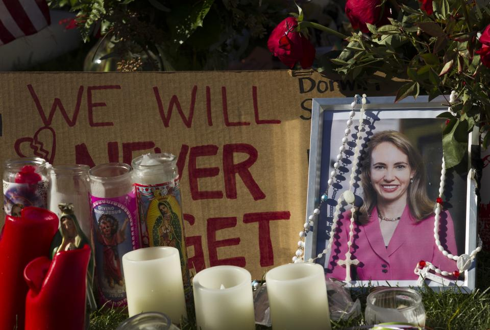 A picture of Rep. Gabrielle Giffords, D-Ariz., is seen at a makeshift memorial in front of the University Medical Center Wednesday, Jan. 12, 2011, in Tucson, Ariz. Giffords was shot on Saturday and remains in critical condition at the hospital. (AP Photo/Morry Gash)