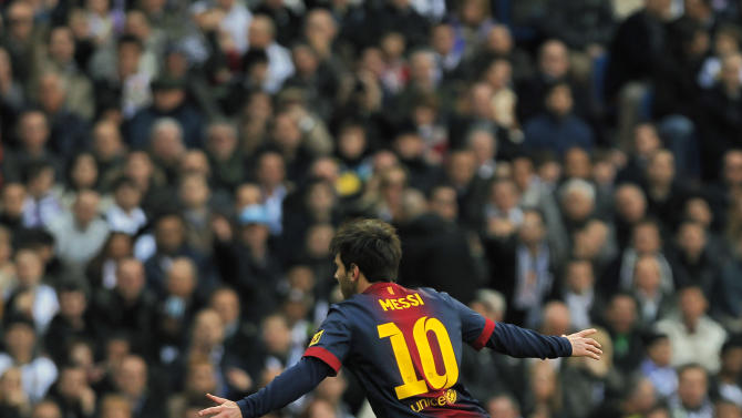 FC Barcelona's Lionel Messi from Argentina celebrates his goal during a Spanish La Liga soccer match against Real Madrid at the Santiago Bernabeu stadium in Madrid, Spain, Saturday, March 2, 2013. (AP Photo/Andres Kudacki)