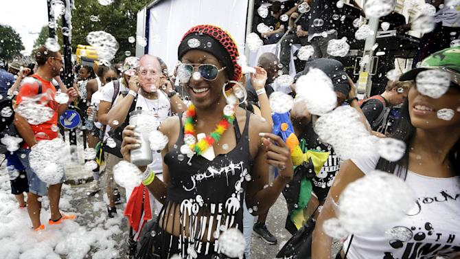 Dancers are covered in bubbles at the Notting Hill Carnival