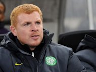 Celtic's coach Neil Lennon looks on during a Europa League match against Udinese in December 2011. Celtic have crashed to a surprise 1-0 defeat against Europe-bound Dundee United as Scott Robertson's header sealed the points at Tannadice