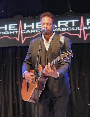 In this photo taken on Wednesday, May 21, 2014, actor Gary Dourdan performs at the Heart Fund Charity Ball in Cannes, Southern France. The gala for the Heart Fund foundation was designed to raise awareness and funds for the group which provides heart care to needy children worldwide. (AP Photo/Nekesa Moody)
