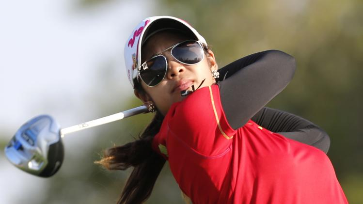Pornanong Phatlum of Thailand tees off on the 16th hole during the Dubai Ladies Masters golf tournament in Dubai