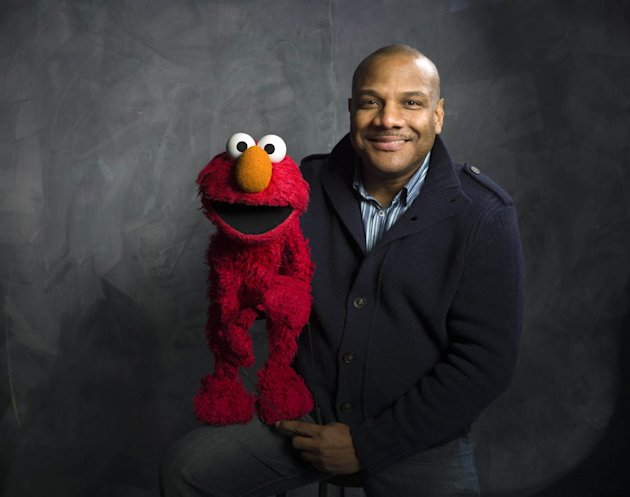 "FILE - This Jan. 24, 2011 photo shows ""Sesame Street"" muppet Elmo and puppeteer Kevin Clash poses for a portrait in the Fender Music Lodge during the 2011 Sundance Film Festival to promote the film ""B"