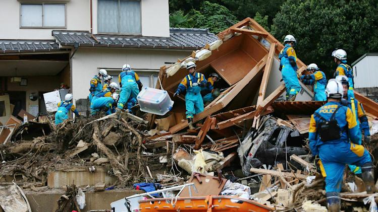 Rescue workers search for missing people after a landslide hit a residential area in Hiroshima, western Japan on August 20, 2014