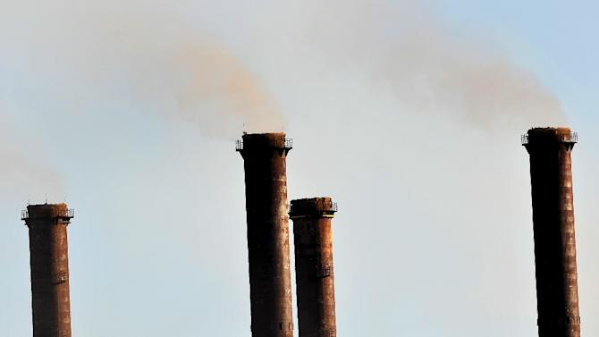 Factory exhaust stacks belch smoke in Latrobe Valley, east of Melbourne, on August 13, 2009