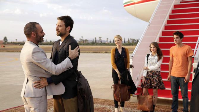 "This image released by FX shows Ashraf Barhom, from left, Adam Rayner, Jennifer Finnegan, Anne Winters and Noah Silver in a scene from ""Tyrant,"" premiering June 24. The series focuses on the youngest son of a Middle Eastern nation's dictator who returns from America after 20 years for his nephew's wedding, only to be thrown back into the turbulent familial and national politics of his youth. (AP Photo/FX, Patrick Harbron)"
