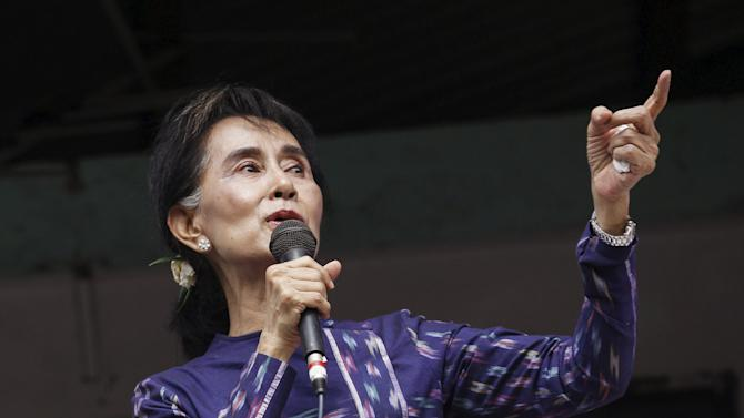 Suu Kyi gives speech during her during her door-to-door visits for voter education campaign at Warheinkha village